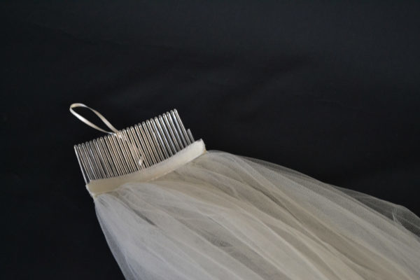 Hair comb with veil